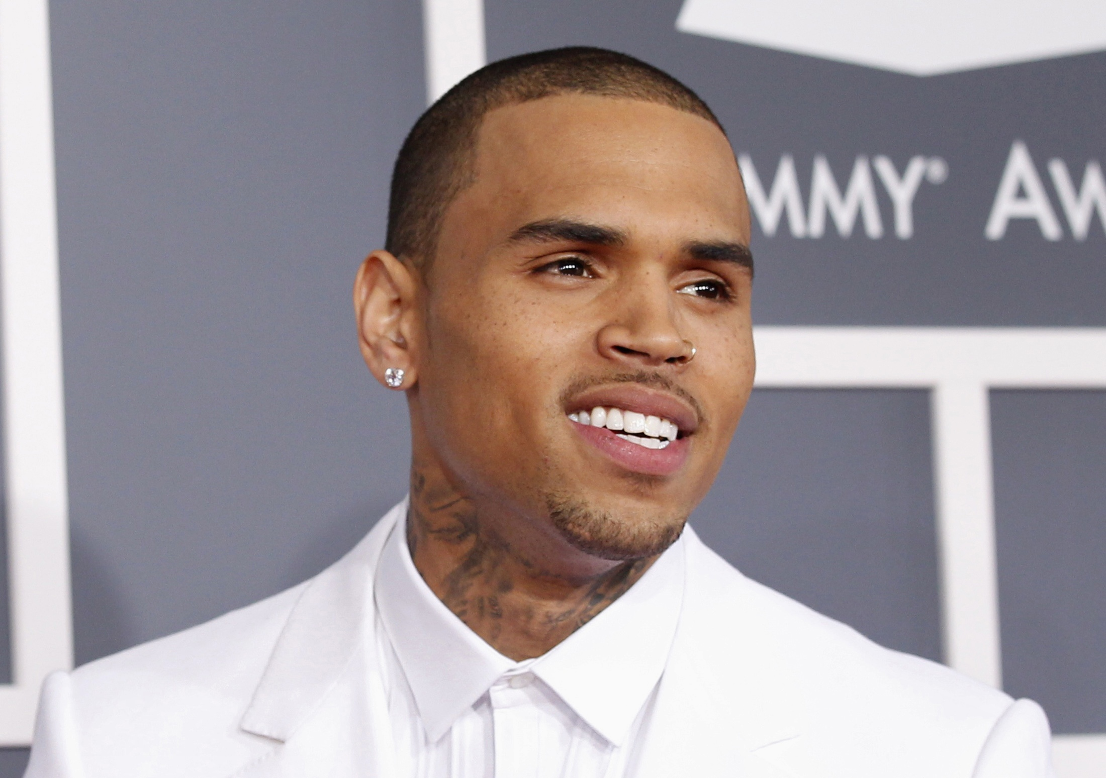 Singer Chris Brown arrives at the 55th annual Grammy Awards in L